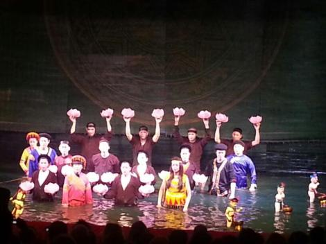 Puppeteers with their water puppets