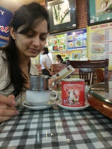 Perplexed looking Parvati with Vietnamese coffee-which is essentially French press coffee but with condensed milk :)