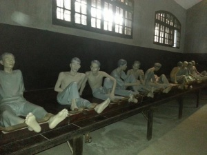 Wax statues showing how Vietnamese prisoners were imprisoned by the French